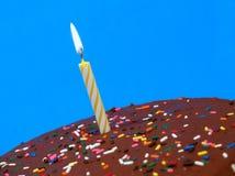 Chocolate birthday cake with candle stock photo