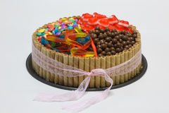 Chocolate birthday cake with candy on top Royalty Free Stock Photography