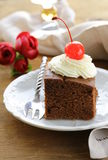 Chocolate birthday cake with cherries and  cream Royalty Free Stock Photos