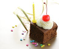 Chocolate birthday cake with cherries and  cream Stock Photo