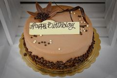 Chocolate birthday cake with Happy Birthday Sign Stock Photos