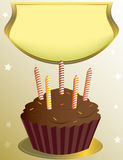 Chocolate birthday cupcake with placard. On tan star background Royalty Free Stock Photo