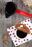 Chocolate biscotti with almonds and cup of coffee red coffee pot Royalty Free Stock Images