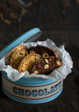 Chocolate biscotti with hazelnuts in vintage metal box Royalty Free Stock Photography