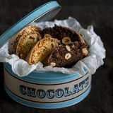 Chocolate biscotti with hazelnuts in vintage metal box Stock Photos
