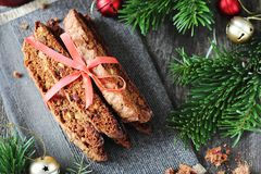Bunch of Chocolate Biscotti with pistachios and cranberries. Chocolate Biscotti with pistachios and cranberries in a New Year`s decor stock photos