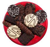 Chocolate biscuit asortment isolated on red plate Royalty Free Stock Image