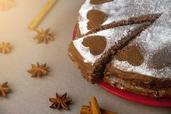 Chocolate Biscuit Cake with Cocoa Cream with Small Hearts from Powdered Sugar. Dessert. Valentine`s Day Concept. Chocolate Biscuit Cake with Cocoa Cream with royalty free stock images