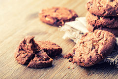 Chocolate biscuit cookies. Chocolate cookies on white linen napkin on wooden table Royalty Free Stock Photography