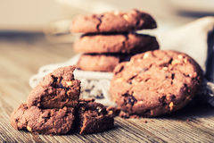 Chocolate biscuit cookies. Chocolate cookies on white linen napkin on wooden table Stock Photo