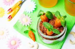 Chocolate biscuit in a jar and dried apricots cashew candies in Stock Photos