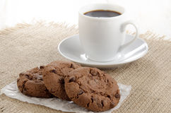 Chocolate biscuit on white paper Royalty Free Stock Photos