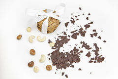 Chocolate biscuits. Three chocolate biscuits as a gift wrapped with ribbon and chocolate chips and nuts Royalty Free Stock Photo