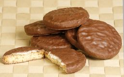 Chocolate biscuits. With mint centers on a woven mat Stock Image