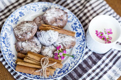 Chocolate biscuits  with cinnamon sticks and cup of milk Stock Photo