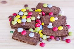 Chocolate biscuits with colorful candy Royalty Free Stock Image