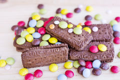 Chocolate biscuits with colorful Stock Images