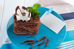 Chocolate biscuits covered with ice cream and mint next to card Royalty Free Stock Photography
