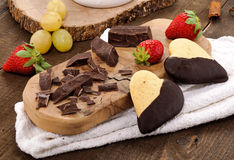 Chocolate, biscuits, grapes and strawberrie Stock Photos