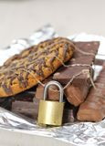 Chocolate and biscuits locked Stock Images