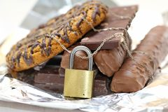 Chocolate and biscuits locked Royalty Free Stock Photos