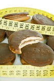 Chocolate biscuits and measure tape Royalty Free Stock Image