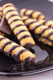 Chocolate biscuits over black plate Stock Images