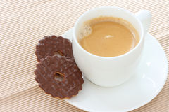 Chocolate biscuits on saucer with coffee Royalty Free Stock Image