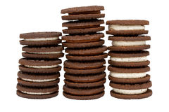 Chocolate Biscuits in Three Piles. Three stacks of chocolate biscuits with chocolate and vanilla cream on an isolated white background Royalty Free Stock Images