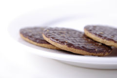 Chocolate biscuits on a white plate Royalty Free Stock Photos