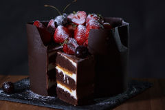 Chocolate bisquit cake with strawberries and cherries. Sweet dishes Royalty Free Stock Photography