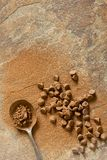 Chocolate Bits and Cocoa Powder on Stone Background Top View stock photo