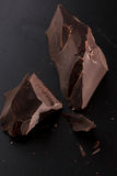Chocolate on black background royalty free stock images