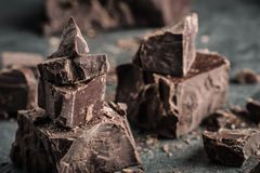 Chocolate. Black chocolate. A few cubes of black chocolate. Chocolate chunks. Chocolate bar pieces Stock Photo