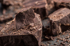 Chocolate. Black chocolate. A few cubes of black chocolate. Chocolate chunks. Chocolate bar pieces Stock Images