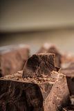 Chocolate. Black chocolate. A few cubes of black chocolate. Chocolate chunks. Chocolate bar pieces Stock Photography