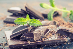 Chocolate. Black chocolate. A few cubes of black chocolate with mint leaves. Stock Photography