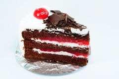 Chocolate black forest and cheery cake with foil. Side of chocolate black forest cake and cherry with foil stock photo