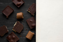 Chocolate on black the old table Royalty Free Stock Photography