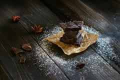 Chocolate on the black table. Dark chocolate. Chocolate chunks Stock Images