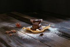 Chocolate on the black table. Dark chocolate. Chocolate chunks Stock Photo