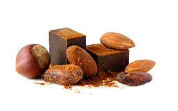 Chocolate blocks with cocoa beans and nuts isolated on white background. Stock Image