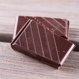 Chocolate in blocks Stock Images