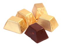 Chocolate Blocks. Wrapped chocolate blocks in white background stock photos