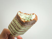 Chocolate and blue mint ice cream stick stock images