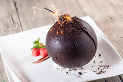 Chocolate bomb. A dish is very interesting Stock Photos