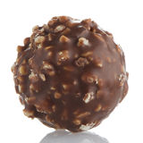 Chocolate bonbon. On a white reflective background stock image
