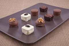 Chocolate bonbon pralines. On a brown plate Stock Photography