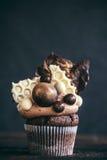 Chocolate bonbons cupcake Stock Images