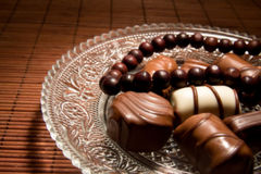 Chocolate bonbons and necklace Royalty Free Stock Photo